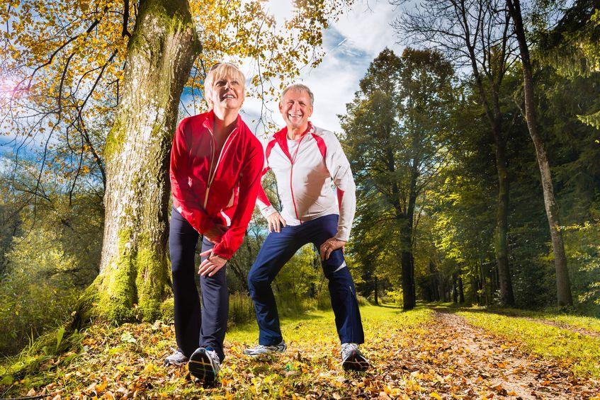 senior couple exercising outdoors